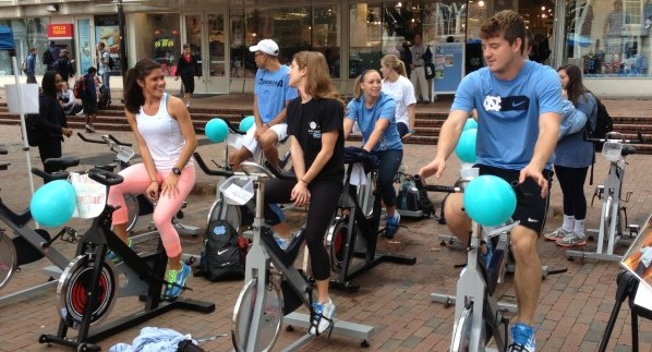 UNC students planned to pedal 7402 miles on stationary bikes to raise money for Ugandan schools. (Photo by Charlie Shelton)