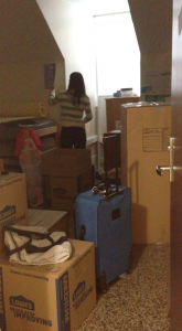 Residents of the top floor of Cobb dorm pack up their belongings. They're being forced to move because of a fire in the building's attic. (Photo by Eden Ye)