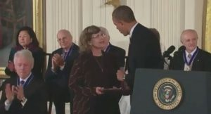 Linnea Smith, Dean Smith's wife, accepts the Presidential Medal of Freedom at a White House ceremony. (Photo from whitehouse.gov)