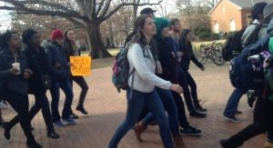 Dozens of UNC Students marched from the Pit to the Silent Sam monument Friday with a simple message to the university: rename Saunders Hall. Photo by )