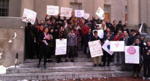 Students and faculty members speak out against low salaries for adjunct faculty.  (Photo by Jessica Coates)