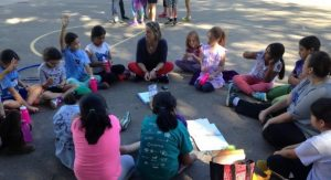 Girls participate in a lesson as part of a Girls on the Run session at Frank Porter Graham Bilingüe Elementary School in Chapel Hill. (Photo courtesy of Tatiana Quiroga)
