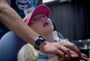 Student Rob Dallara guides Daisy Hester through a computer game during Maze Day 2014. The Computer Science department has held the annual event for twelve years. (Photo courtesy UNC Office of Communications and Public Affairs)