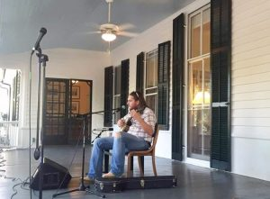 Nathan Bowles, playing guitar, at the center for the study of the American south. Photo courtesy of the Paradise of Bachelors website.