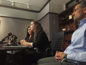 Robinson (middle), lawyer (left) and father (right) at the press conference on September 13th