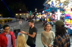 Three BYX fraternity brothers try to decide with their dates what to do next after a Ferris wheel ride at the N.C. State Fair on Thursday night, Oct. 13.
