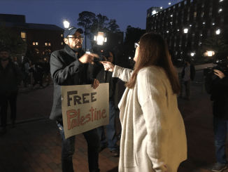Deborah Friedman confronts protester Andrew Curley on her way to the Genome Science Building to hear Sebastian Gorka's speech Monday evening. (Jay Siebold/Carolina Connection)